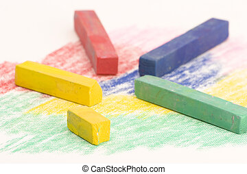 Multi Coloured Chalk sticks on a coloured background
