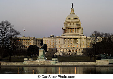 Capitol Hill at dusk - US Senate building at National Mall,...