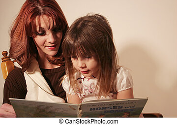 Mother and Daughter - A mother and daughter are reading a...