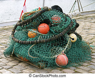 Harbour 6 - A large collection of fishing nets and floats in...