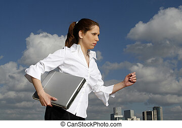 Business woman and her laptop blue skies in the background