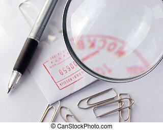 pen and stumped envelop under magnifier - pen,some clipes...