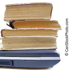 Information progress - Laptop and old books isolated on a...
