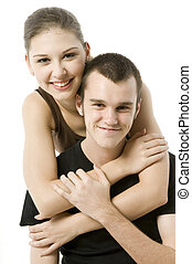 Girl and Guy - A young couple holding each other on white...