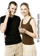 Modern Young Couple - A young couple using their mobile...