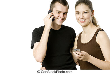 High Tech Couple - A young man and woman using mobile...