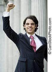 Success - A young businessman punching the air with delight