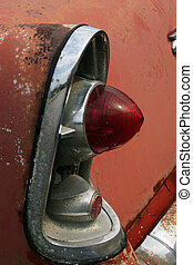 Tail Light in Rust - An old tail light in a rusted car.
