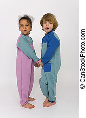 United Colors - A young boy and girl holding hands and...