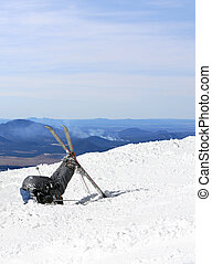 A skier buries his head in the snow after failing to perform...