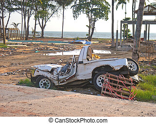 Car Wreckage - The wreckage of a car lies on the beach at...
