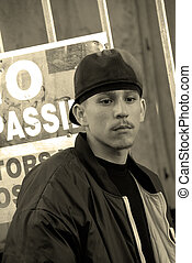 Latino Teenage Boy In An Alley - No Trespassing - A teenage...