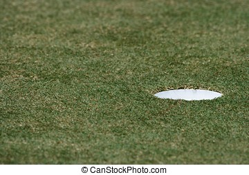 Hole In The Golf Field - A close up of hole in the golf...