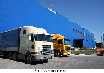lorries on a background of a dark blue warehouse