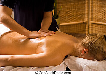 Back Massage - woman at a day spa getting a nice massage