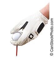 Tee up - Isolated glove hand setting a golf ball