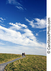 Walkway to heaven  - elderly couple walking on path