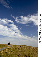Walkway to heaven - An elderly couple walking on a path to a...