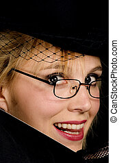 Smiling lady in hat.