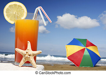 Tropical Drink - Tropical cocktail with starfish with...