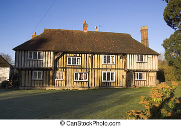 Tudor House - A tudor house in the UK with a blue sky