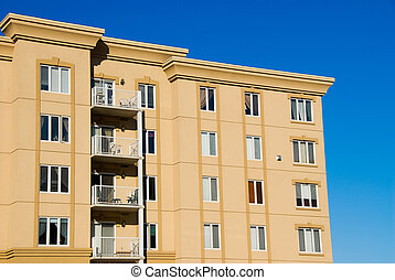 Side views condos - modern beige and brown apartment condos...