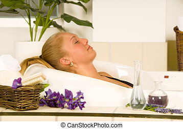 Spa - blond woman in a spa bath relaxing