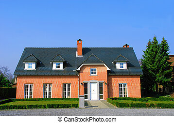 Residential house in the suburbs, bright sunny day, blue sky...