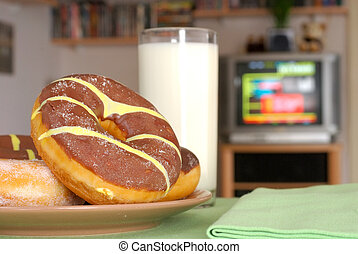 TV dinner, snack, chocolate donuts - Having a snack on a...