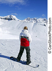 Mountains snowboarding - Girl on snowboard enjoying scenic...