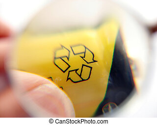 recycle symbol on a battery being holded by fingers close up...