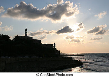 Old Jaffa Silhouette - A silhouette of the harbor and the...