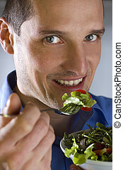 salad - young men eating salad close up shoot