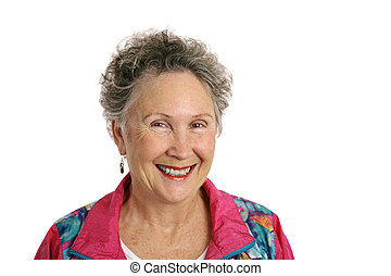Happy Retiree - A smiling, happy retired woman wearing a...
