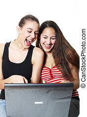 Giggling Teenagers Surf - Two girls laughing and surfing the...