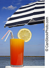 Tropical Drink - Tropical drink with sunny beach and parasol...