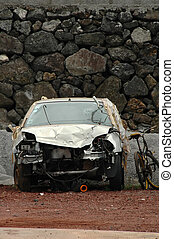 Car wreck near a stone wall in the Azores islands
