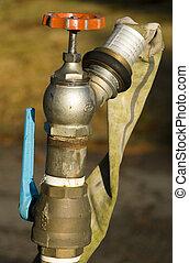 Water Hose with Valves - Water hose with valves on a golf...