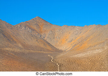 Lone Dirt Road in the Mountains of Death Valley - Lone Dirt...