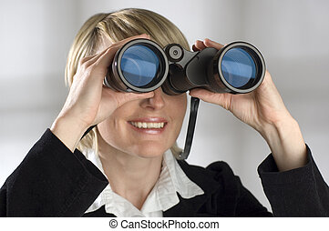 binocular - young blond women looking through binocular -...
