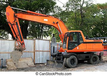 Orange Loader - Orange front end loader at a job site