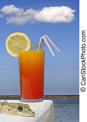 Tropical Scene - Tropical drink and sunny beach background...