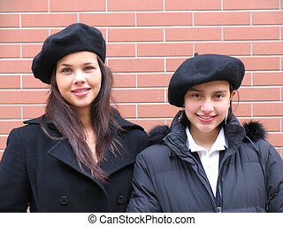 Young girls - Two happy young girls with beret and coats