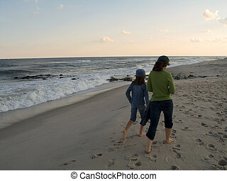 Beach Walk - A mom and daughter walk along a New Jersey...