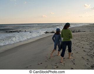 Beach Walk - A mom and daughter walk along a New Jersey...