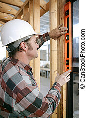 Leveling Window Vertical - A construction worker checking...