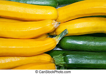 Zucchini vegetable - Yellow and green zucchini vegetable on...