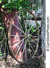 Old Wagon Wheel - A large old wagon wheel in the bush
