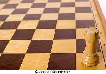 Rook - Lonely white rook on chess table, focus on bottom of...