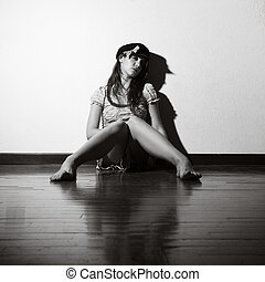 loneliness: woman sitting on the floor crying